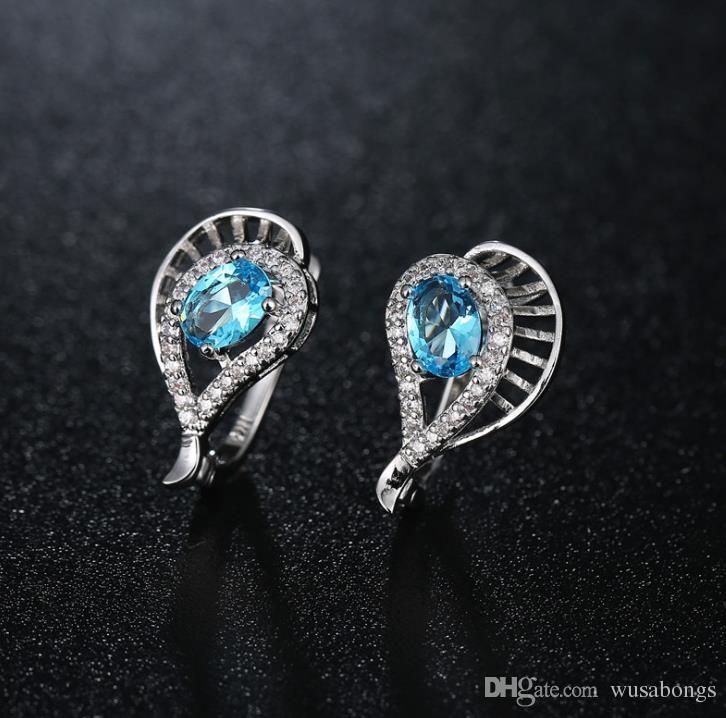 Pendientes de diamantes y aretes de cristal de circón Pendientes geométricos calados Pendientes de lágrima