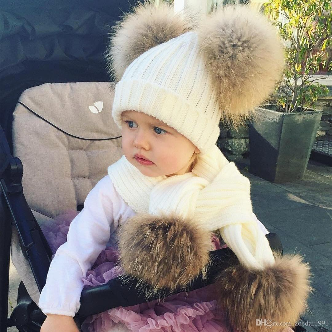 f9014d9c9ba 2019 Real Fur Kids Girls Boys Knitting Hat Scarf Set With Four Double Two  Raccoon Pompoms Ball Cap Beanie Scarves Suit From Zoedai1991