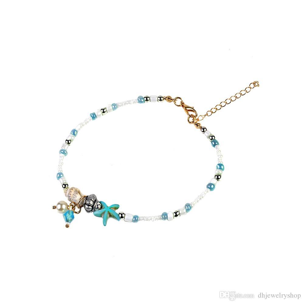I gioielli del braccialetto delle perle del sandalo della catena del piede della catena del piede della spiaggia di Shell delle stelle marine d'annata di estate