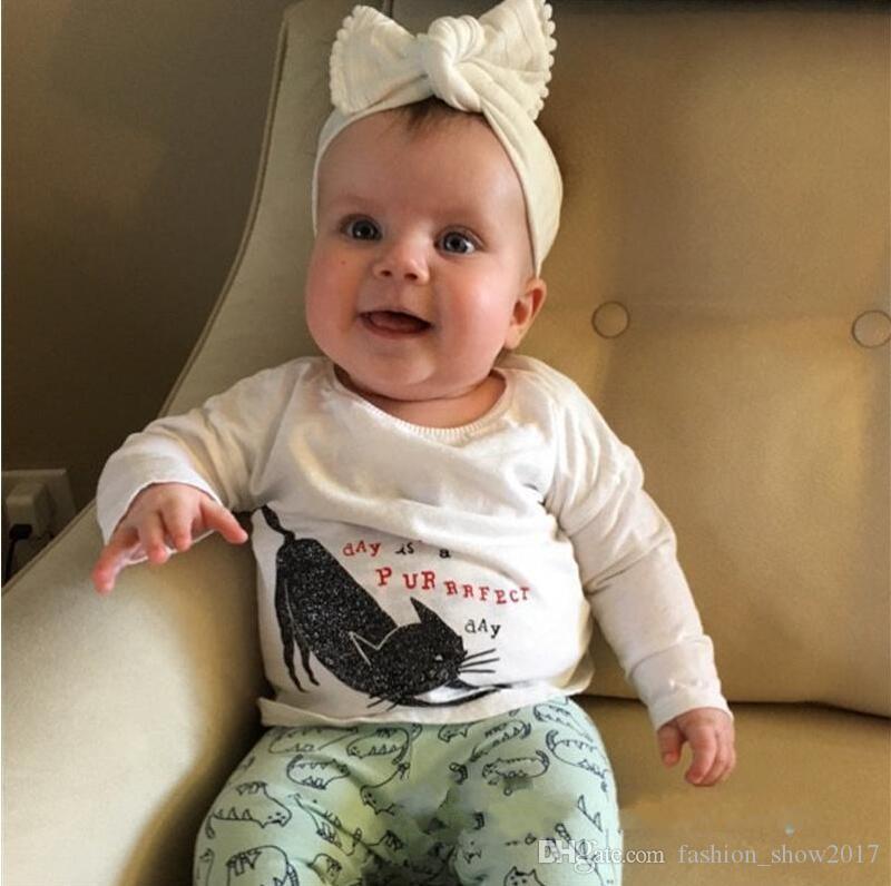 Más nuevos encantadores calientes del bebé arcos de las vendas con las borlas niños anchos de algodón de las vendas niños niños accesorios para el cabello