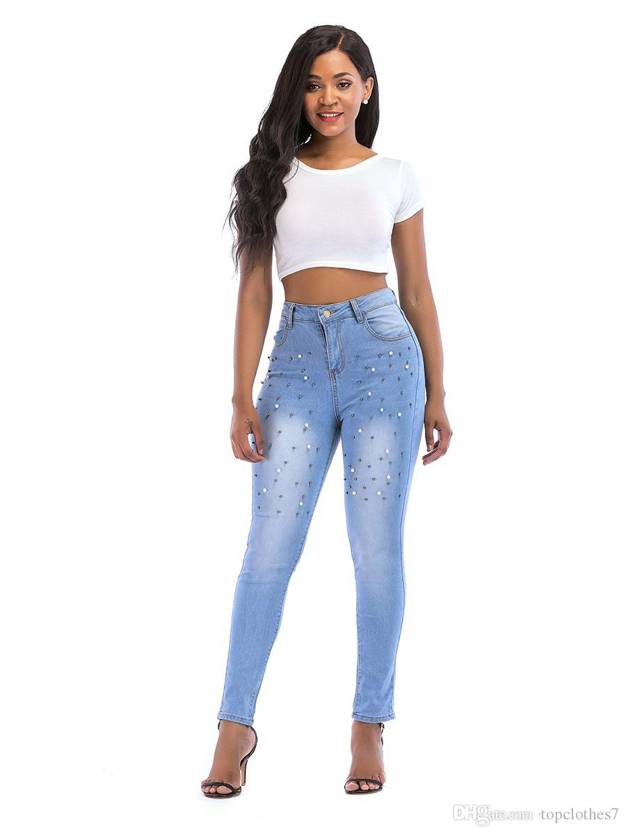 66a403a2b1 Jeans stretti dei jeans delle donne dei jeans strappati buco di vendita  caldi Jeans diritti dell annata dei jeans freddi della ragazza per i  pantaloni ...