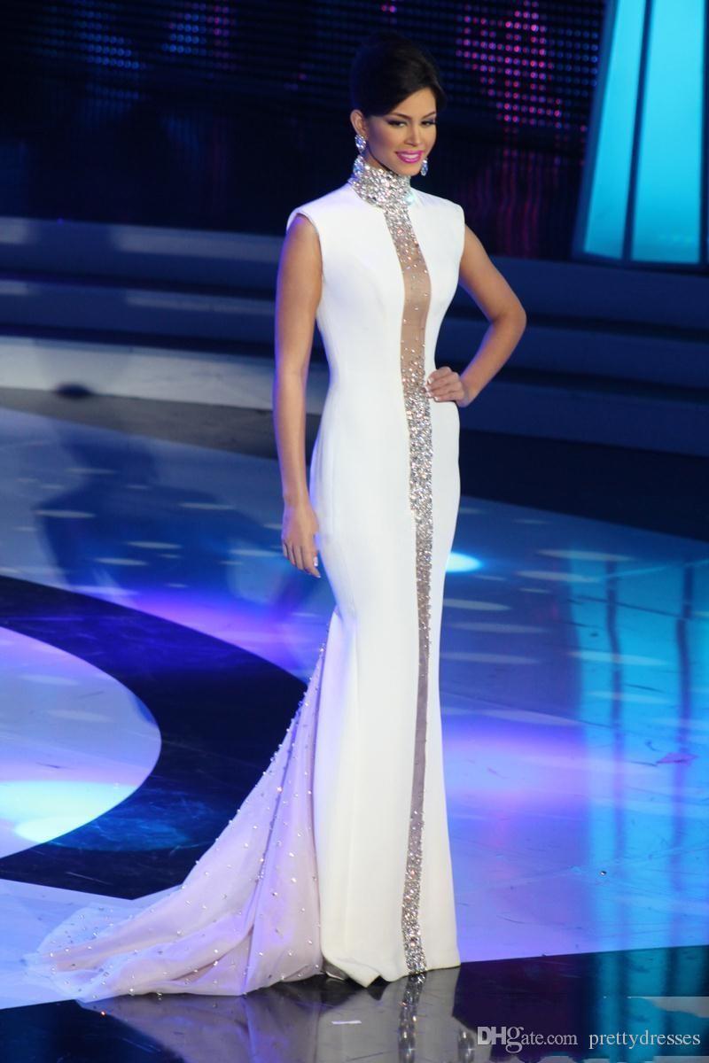 2018 Elegantes vestidos de noche de cuello alto Cristales de Bling blancos Gorra con cuentas Sin mangas Tul Sirena Vestidos de celebridades delgados Vestidos de fiesta formales Fiesta