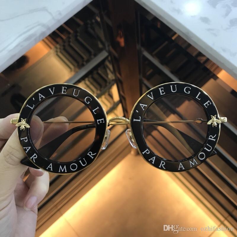 Compre Mulheres Inspirado Preto De Metal De Ouro Gucci GG0113S Rodada Óculos  De Sol 0113S Mulheres Designer De Marca De Moda Rodada Óculos De Sol 2018  Novo ... c51fb1ad7e