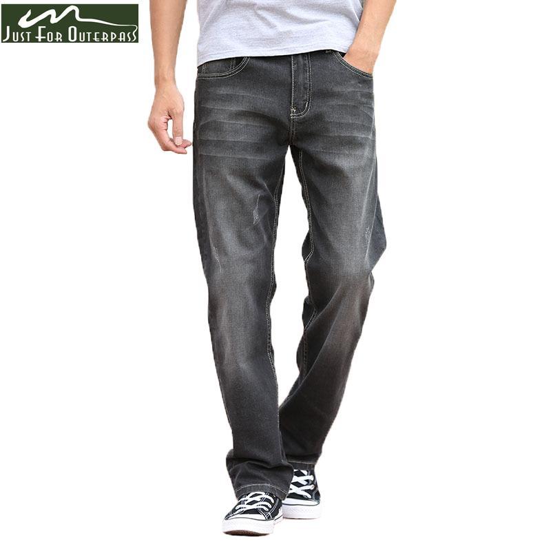 Compre 2018 Moda Verano Jeans Negro Hombres Pantalones Vaqueros Flojos  Ocasionales Pantalones Rectos Transpirable Elástico Cómodo Pantalones De  Tendencia ... 21a8aacc00bf