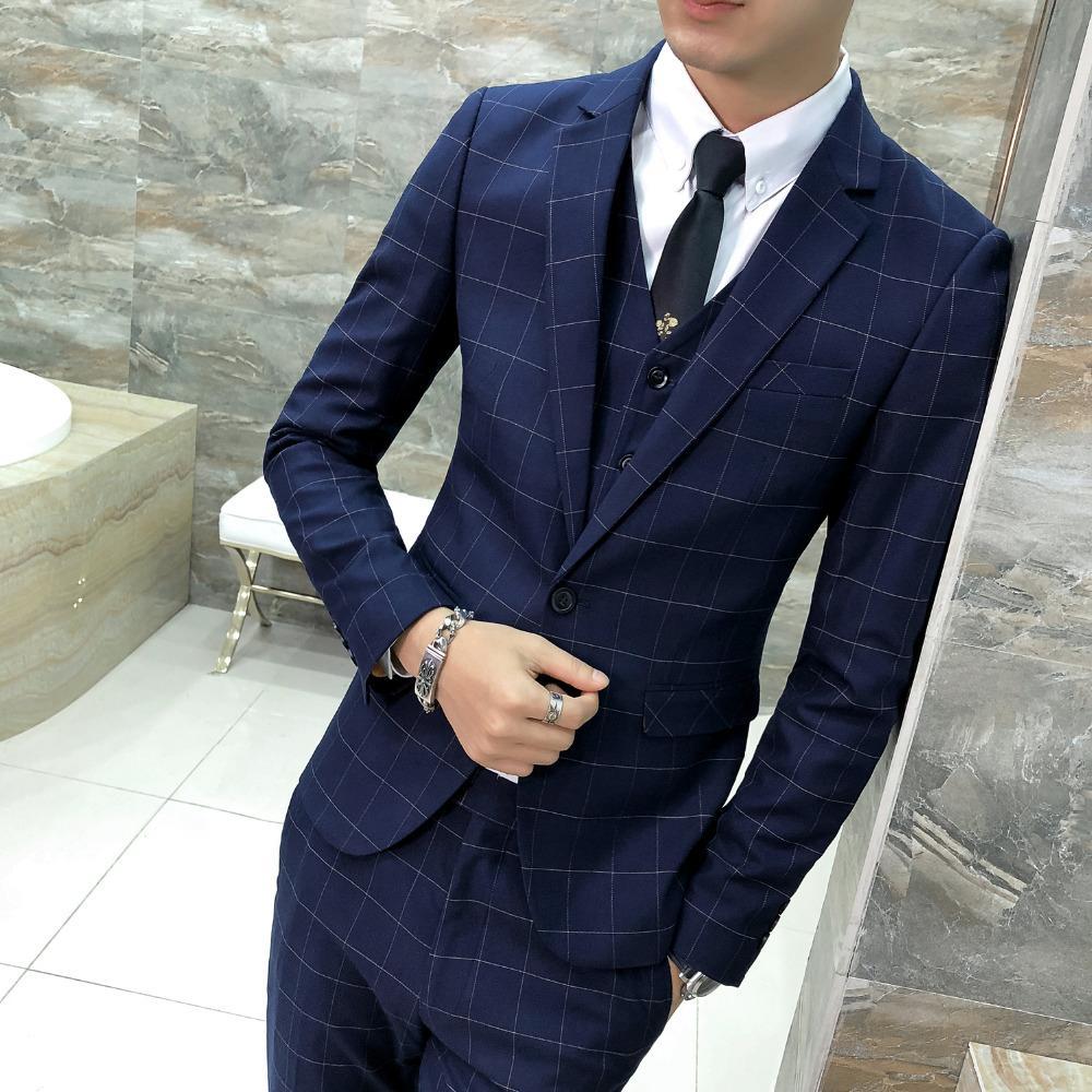 Compre Clásico Azul Marino Hombres Blazer Moda 2018 Otoño Slim Fit Vestido  A Cuadros Blazer Hombres Chaqueta Un Botón Anfitrión Caballeros Traje  Abrigos A ... 8e37bc94676