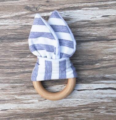 New Baby Massaggiagengive Anello di legno Baby Molars Denti Giocattoli allenamento Infantili Sonagli le mani Regalo di babys neonato Esercizi Giocattoli Denti giocattolo allenamento KKA1