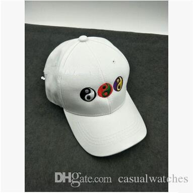Embroidery applique with dazzling rhinestones on a black distressed baseball  cap. All school/team colors available.