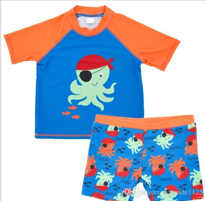 Ins Art und Weise scherzt heißer verkaufender Junge zweiteiliger gesetzter Badeanzug-Sommer Junge nette Blume Sharlk Druck-Schwimmenkleidung 4 Arten geben Schiff frei