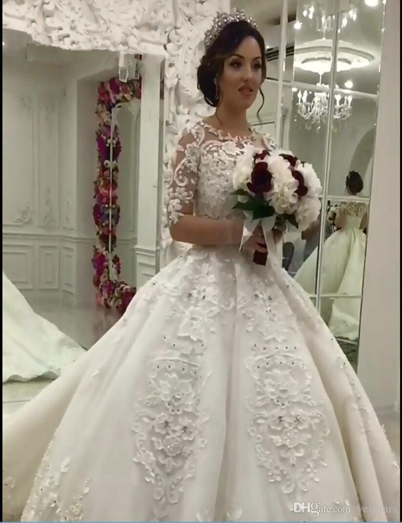 2018 Ball Gown Wedding Dresses Arabic Jewel Neck Half Sleeves Illusion Tulle  Lace Applique Beads Pearls Button Back Long Formal Bridal Gowns Plus Size  ... 79a15231ecec