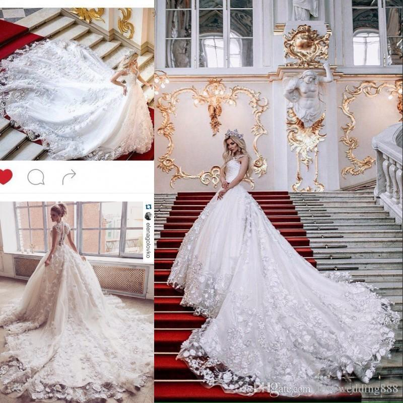 2019 Glamorous 3D Floral Appliques Lace Wedding Dresses A-Line Tulle Key-Whole Sheer Back Sexy Bridal Dresses Long Chapel Train