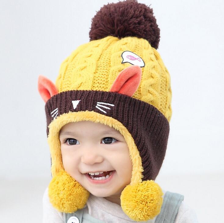 Invierno lindo bebé niños gorro de lana orejeras beanies cráneo bebé  caliente gorros de lana tejida de invierno dibujos animados gato orejeras gorros  para ... cdd7ed6b3d3
