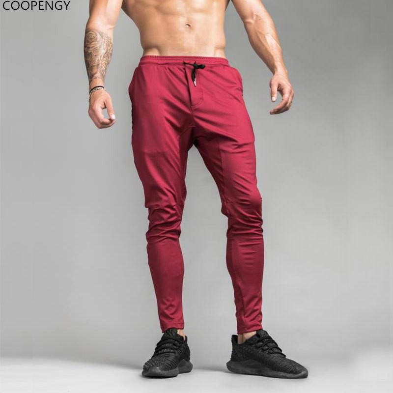4022ca0c862 2019 Mens Joggers Casual Pants Fitness Men Sportswear Tracksuit Bottoms  Skinny Sweatpants Trousers Black Gyms Jogger Track Pants 2018 From  Liuyang2016