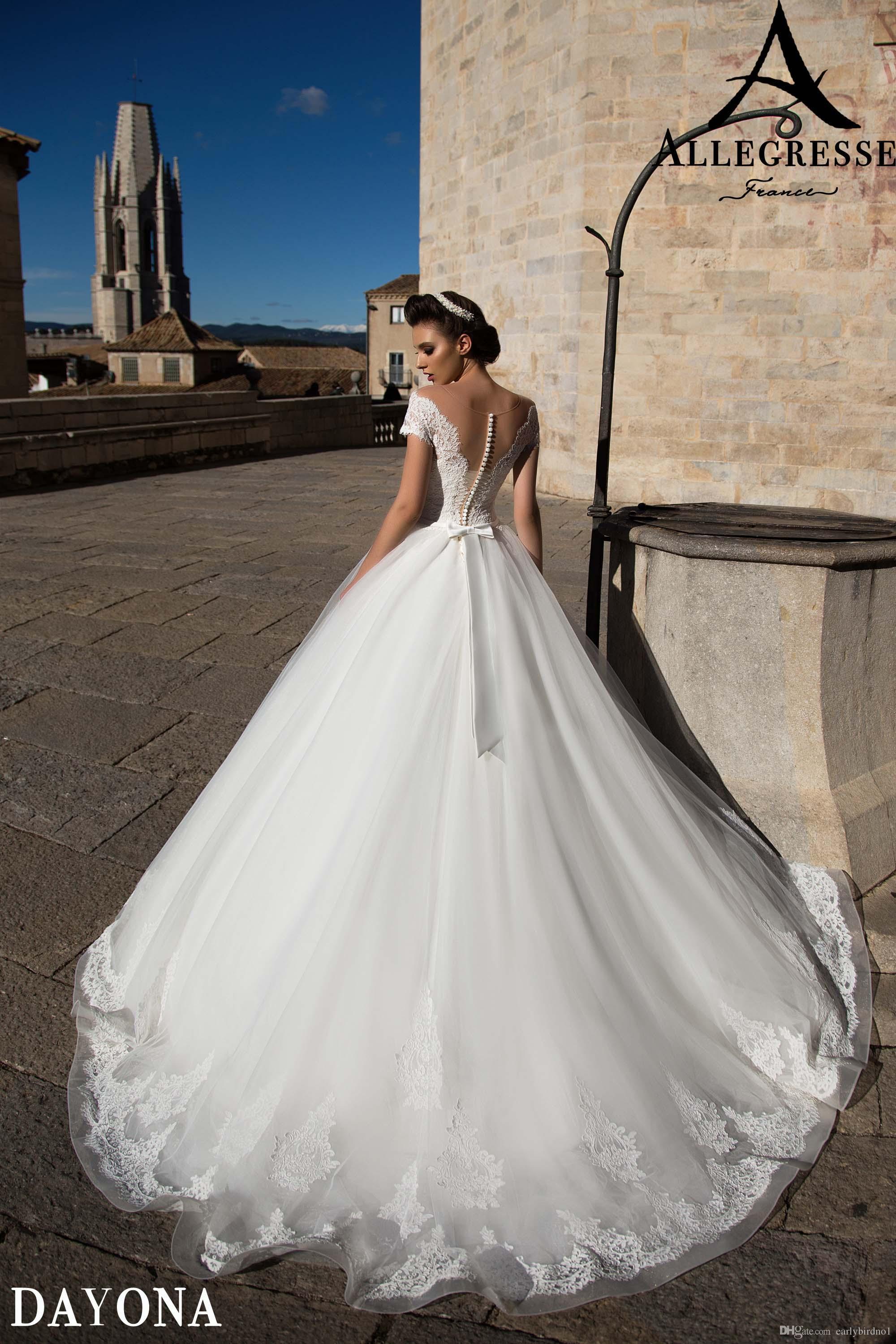 Mais novo Branco A Linha de Vestidos de Casamento Rendas Tule Mangas Curtas Sheer Scoop Pescoço Apliques Vestidos De Casamento Com Botão de Arco de Trás Da Varredura Do Trem