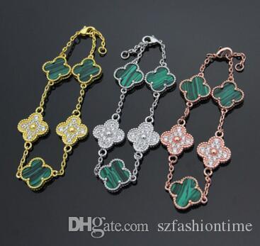 Großhandelsaußenhandel, der Schwarzweiss-Blumenarmband vier Blattblume zwischen rosafarbenem Goldarmband des Rosas 18K verkauft