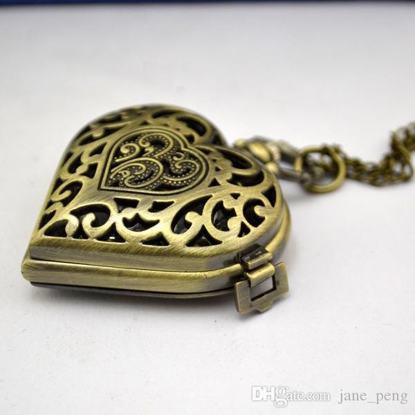 Bronze Skeleton Antike Taschen-Uhren Weinlese Steampunk Herz-Silber-Anhänger Halsketten Uhren Quarz-Frauen-Weihnachtsgeschenk-Männer Uhren