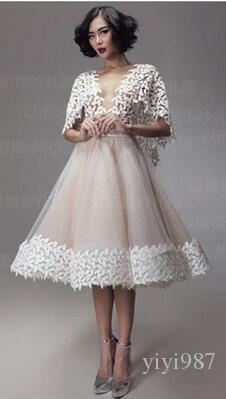 2020 nouvelles robes de soirée courtes Wrapped dentelle Châle Une ligne en organza Champagne Voir Par Backless cocktail Robes Livraison gratuite