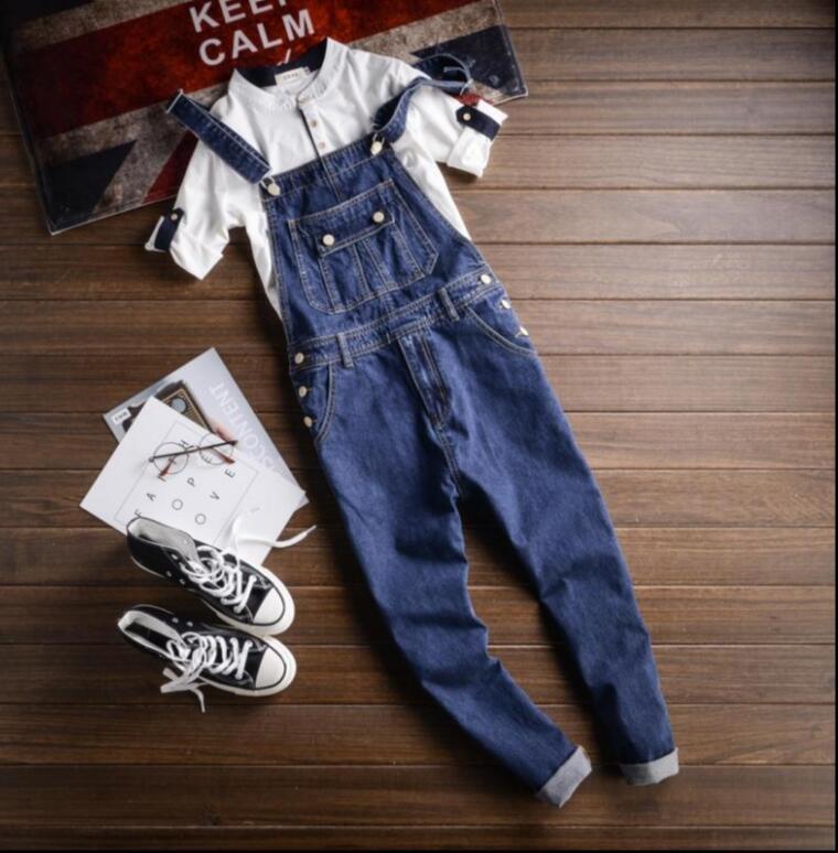 d3fba3a4b82 2018 New men s retro tool suspenders pants Japanese simple wide denim  jumpsuits pants men s fashion strap jeans