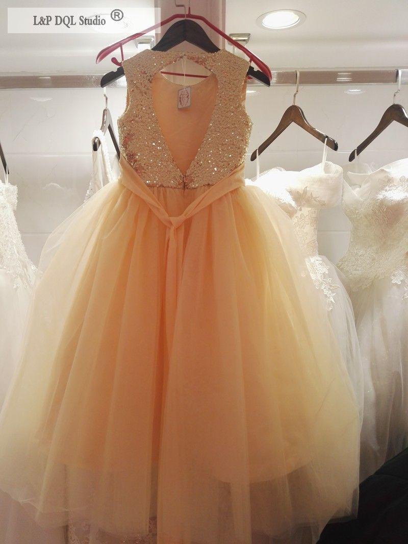 Blumen-Mädchen-Kleider Champagne Tüll Bottom GoldPaillette Top Sleveless Ballkleid Fußboden-Länge mit Bogen-Mädchen-Partei-Kleid