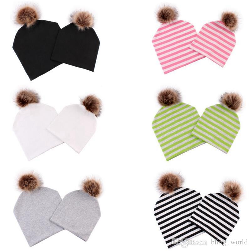 951214550a5 2019 Family Matching Cap Winter Warm Striped Hats Fur Pom Poms Beanie  Luxury Mom Baby Caps Fashion Leisure Outdoor Hats YL514 From Bling world