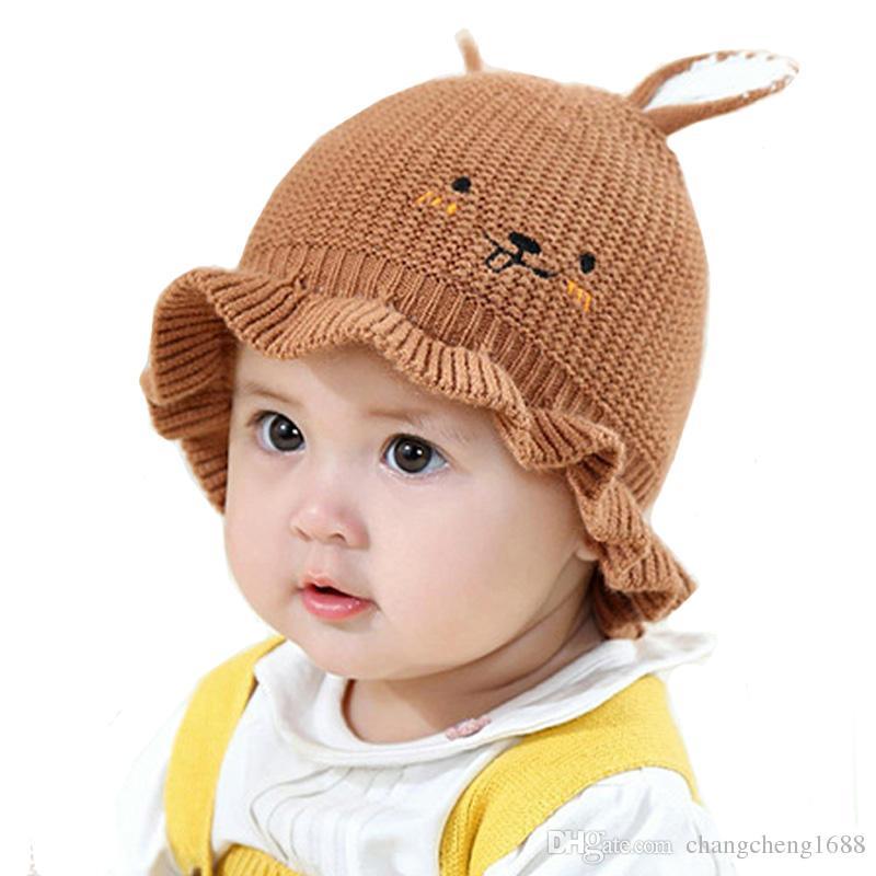 b9e20617f64 2019 Baby Kids Falbala Beanies Hats Boy Girl Skullies Rabbit Ear Design  Solid Knitted Ribbed Skull Cap Child Winter Warm Hat MZ6775 From  Changcheng1688