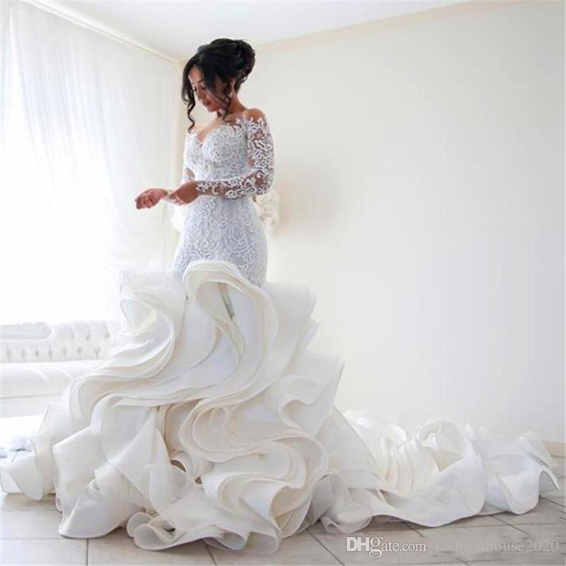 2020 Elegant Mermaid Wedding Dresses Lace Applique Sheer Jewel Neck Long Sleeves Ruffles Tiered Skirts Chapel Train Button Back Bridal Gowns
