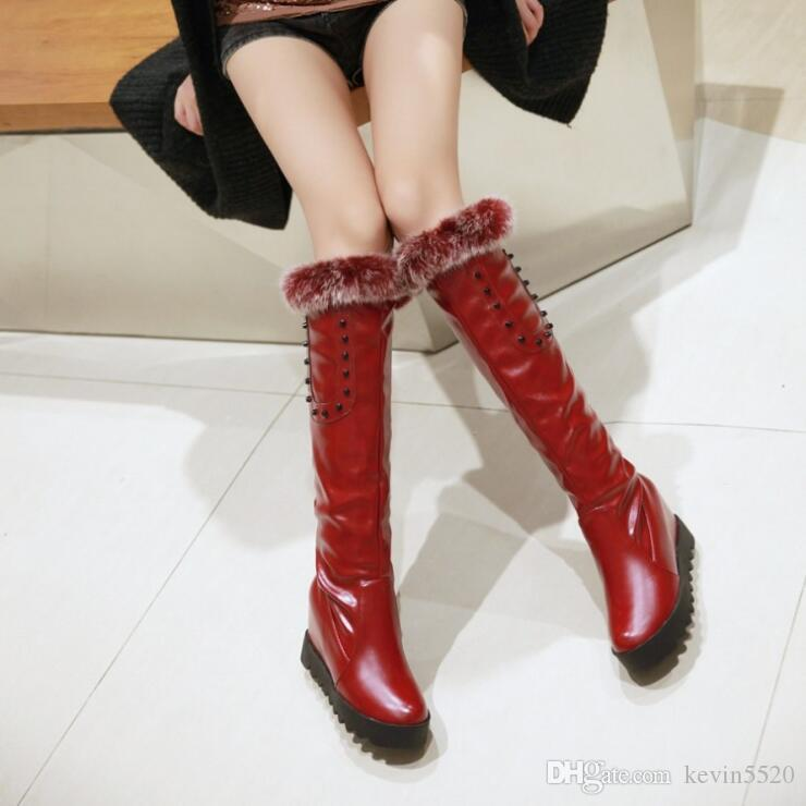 The new women winter snow boots female rabbit hair high metal rivet boots with heighten inside leather boots