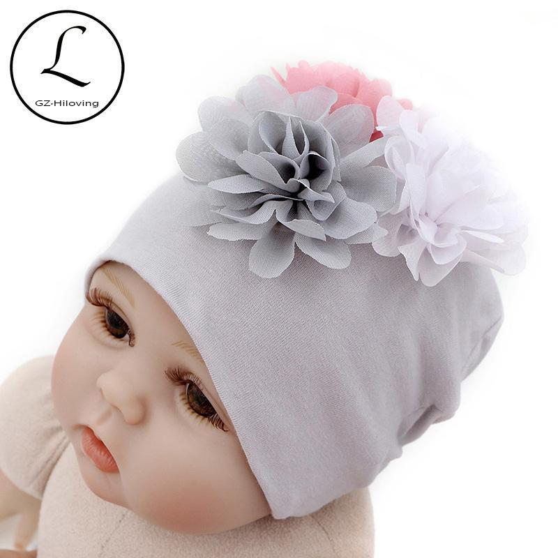 2019 GZHilovingL 2018 New Soft 100 Cotton Flower Hat For Newborn Baby Boys  Girls Kids Warm White Beanie Hat Baby Newborn Accessories From Dejavui d08708bef512