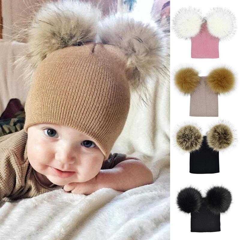 e74fc3a2 2019 Cute Faux Fur Pompom Baby Beanie Winter Warm Knitted Wool Cap Baby  Girl Boy Kids Double Ball Gorro Crochet Hat Boys Winter Hat From Hcaihong,  ...