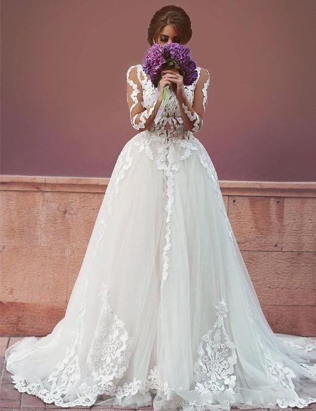 Abiti da sposa oversize con maniche lunghe arabi con tulle e tulle applicati Abito da sposa con tulle e tulle sexy visti attraverso la sirena Abiti da sposa