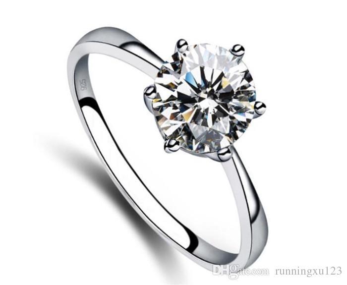 703caf34770d Compre Anillos De Boda De Plata Joyas Anillo De Compromiso Clásico 6 Garras  5 Mm AAA Flechas Suizas Anillo De Diamantes CZ Joyas R207 A  0.64 Del ...