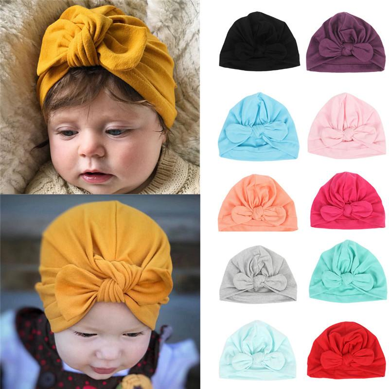 a4e3127b2b4 2019 Newborn Baby Hat Baby Girls Boys Rabbit Ears Bowknot Solid Cotton  Sleep Cap Headwear Caps Accessories Casquette Enfant From Babymom