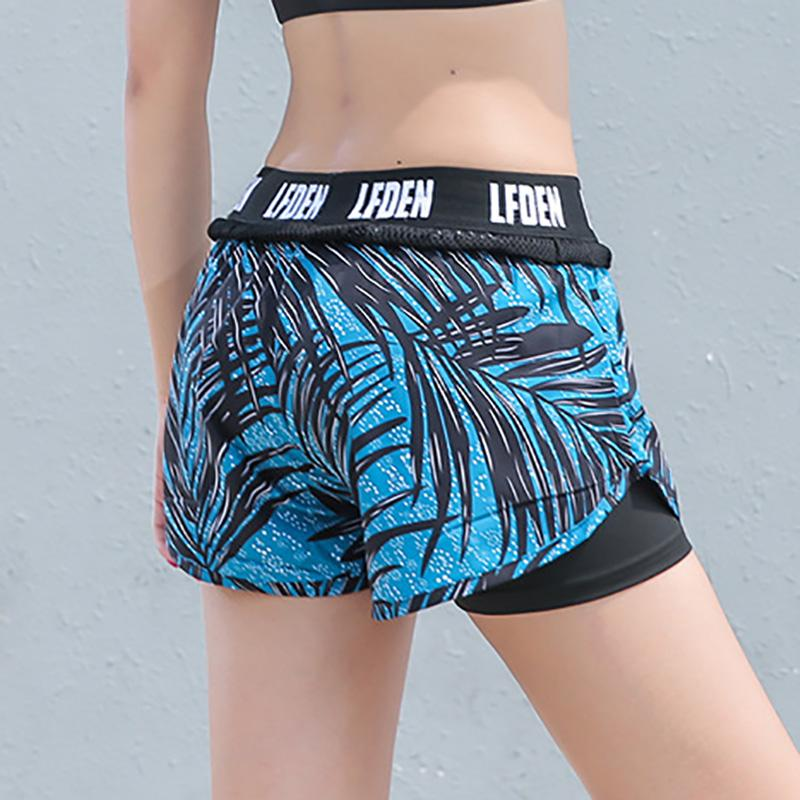 b9bf551312cf9 2019 Women S Yoga Shorts Fast Dry Breathable Inner Lining Anti Light Sports  Running Safety Women S Pants Mesh Letter Printing From Enjoyweekend