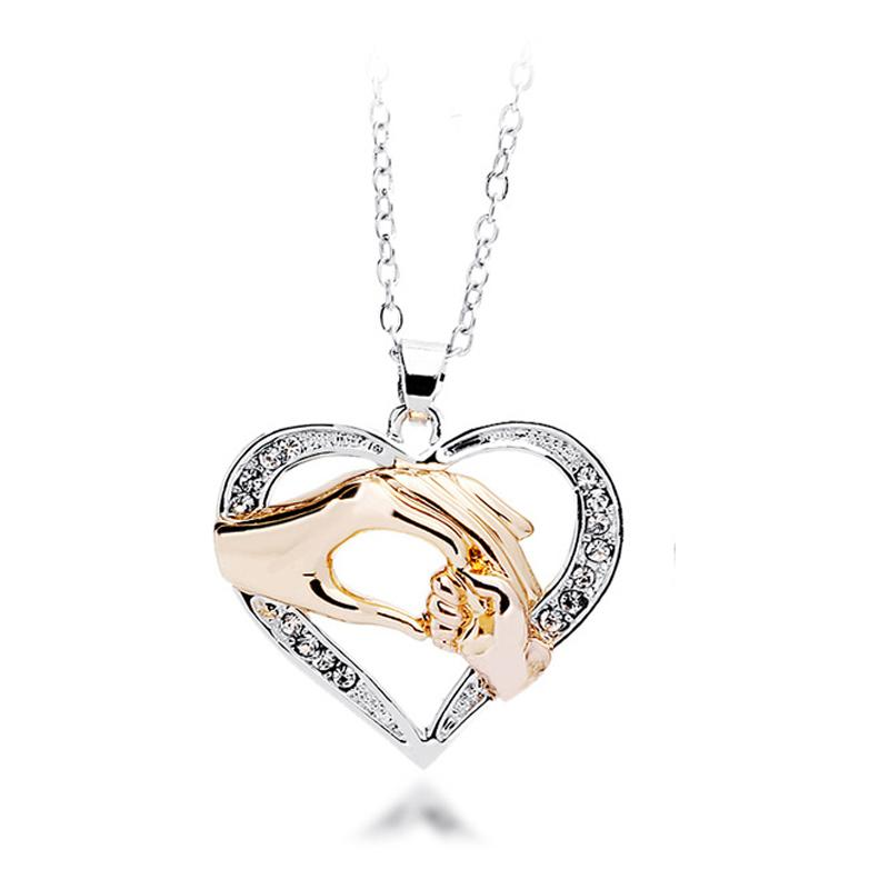 Wholesale mothers day gift mother baby hand holding love heart wholesale mothers day gift mother baby hand holding love heart pendant necklace rose gold mom jewelry rose pendant necklace pendants and necklaces from aloadofball Gallery