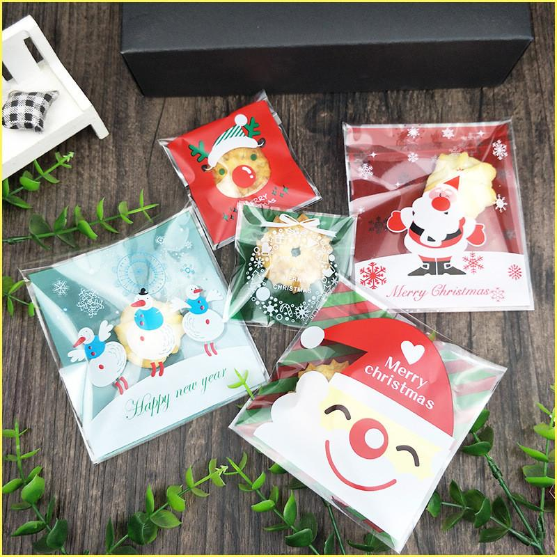 fbac5d0393acd 2019 Cartoon Gift Bag Christmas Cookie DIY Food Self Adhesive Seal  Packaging Plastic Bag Santa Claus Snowman Biscuits Candy Package SF From  Sweet shops