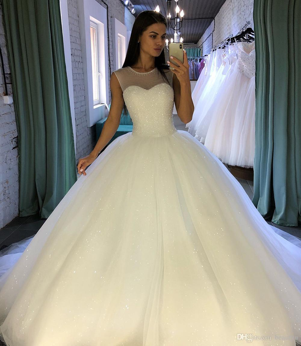 Sparkly Sequined Ball Gown Wedding Dresses 2018 New Robe De Mariée Illusion  Tulle Plus Size Arabic Princess Bridal Gowns Vestido De Novia Dream Wedding  ... 01cf85bb031c