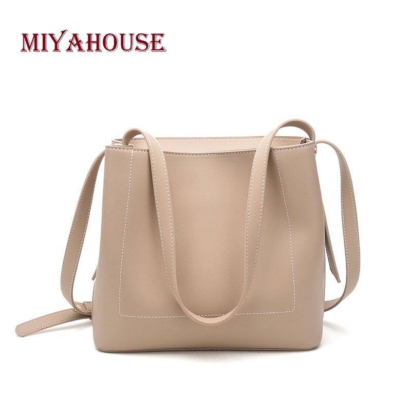 af86cffb0ba MIYAHOUSE Sleek Minimalist Retro Messenger Bag Large Capacity Bucket Bag  Wild Korean Wind Shoulder Female Cheap Designer Handbags Black Handbags  From Serady ...