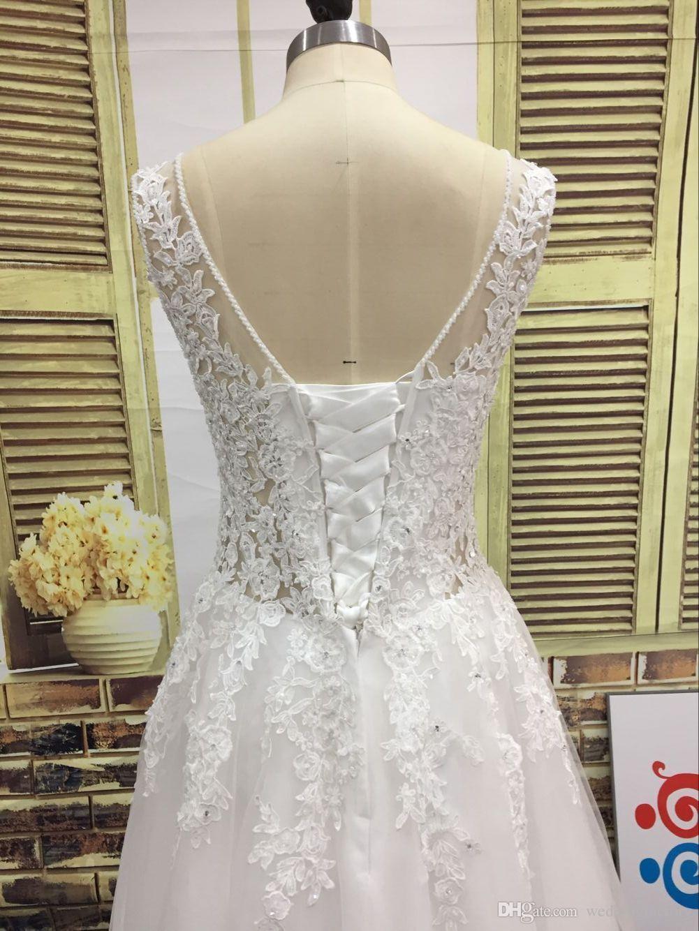 Imagen real Una línea Vestido de novia Con cuentas Escote escarpado Cristales Perlas Lentejuelas Apliques de encaje Ilusión Volver Corsé Longitud del piso Vestido de novia