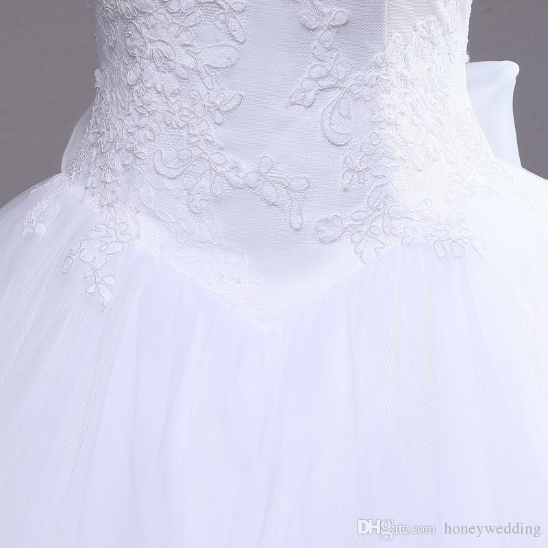 2018 Ball Gown Wedding Gown Spaghetti Straps Lace Appliques Ruched Backless Bowknot Trimmed Wedding Dresses Custom Made