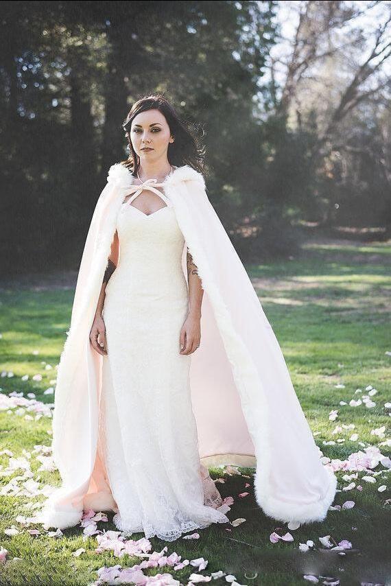 b89a50e7 2019 2019 Bridal Fur Cloak Russian Girls Winter Collection Fashionable  Russian Beauty Fur Hat Ivory Cheap Warm Hooded Wedding Wrap From Caoyueyun,  ...