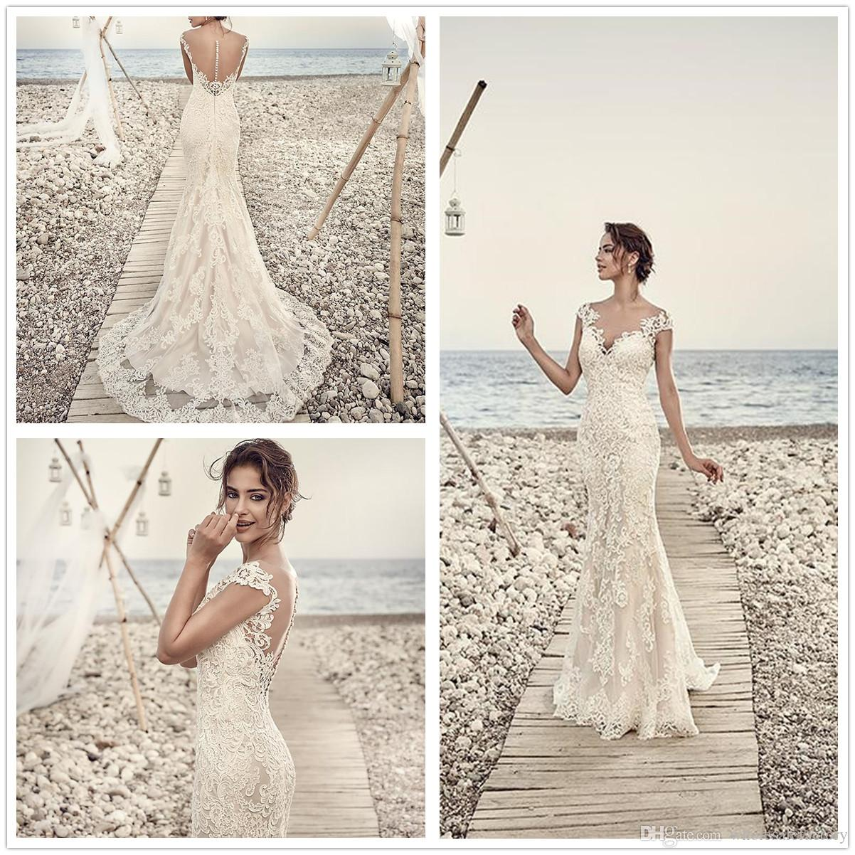 0dda3e397bd1 Elegant Lace Mermaid Wedding Dresses 2018 Sheer Cap Sleeves Tulle Applique  Long Bridal Wedding Gowns With Buttons Couture Mermaid Wedding Dresses  Halter ...