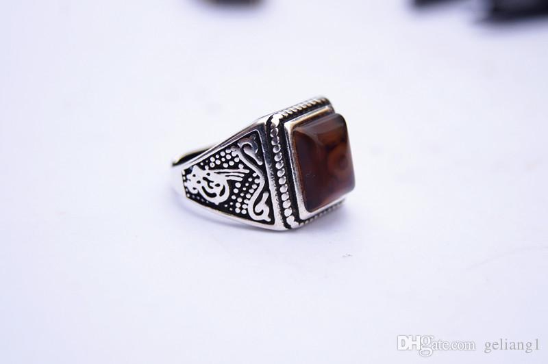 alloy inlaid red Tibetan dragon eyes, rings, square ring surfaces. Successful people's choices.