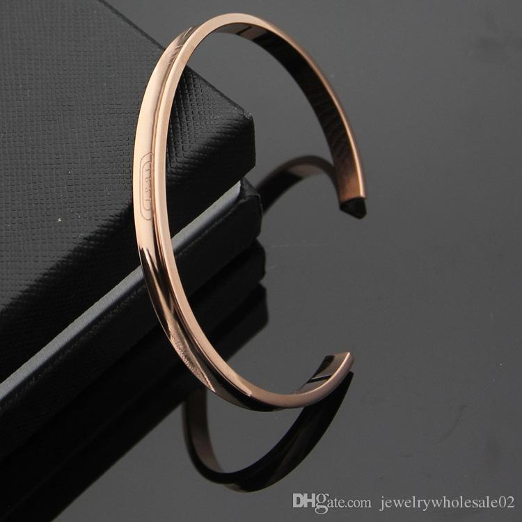 2019 Fashion titanium steel jewelry wholesale T letter C shaped open groove bracelet 18K gold foreign trade money men and women bracelet.