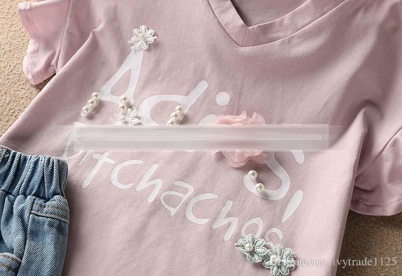 Kindkleidungsmädchen elegantes Blumen mit Perlen Entwurfs-Kurzschlusshülse rundes Kragenhemd + Denimkurzes Mädchenkindersommer stellt freies Schiff ein