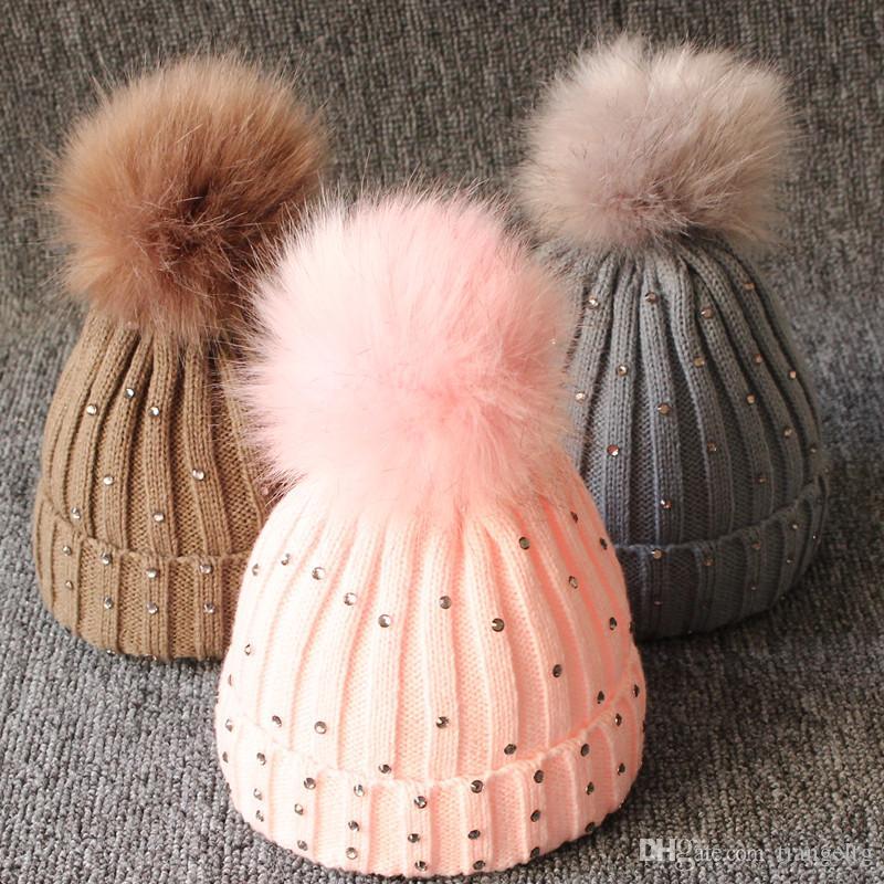 5471e6c2689e8 2019 Baby Knitted Diamonds Hats Fur Pom Pom Beanie Shinning Bling Bling  Bobble Crochet Caps Winter Infant Kids Boy Girl Designer Accessories From  Tiangeltg