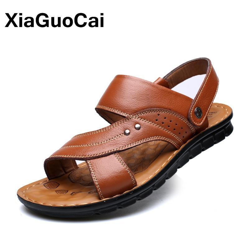 239c3ba5 Compre 2018 Primavera Verano Hombre Sandalias Zapatillas Dos Usos Cuero  Genuino Diapositivas Casual Zapatos De Playa Para Hombre Antideslizante  Mans Mulas ...