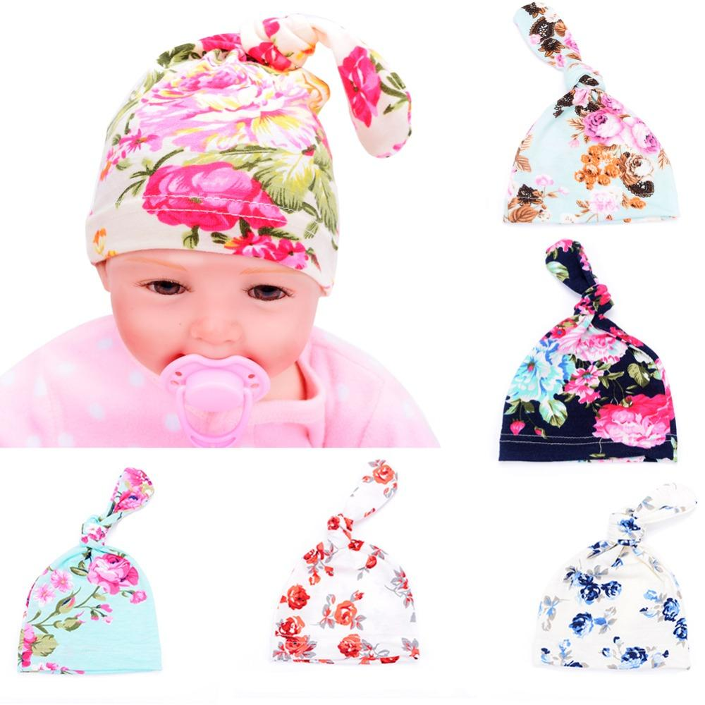 2019 Flower Tie Knot Baby Hat Cappelli Bambino Infant Girls Hospital Cap  Soft Cotton Children S Hats Newborn Photography Props 0 3M From Entent 958d41ab8d3