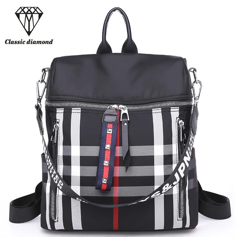 606de7dd1bfa 2018 Women Waterproof Nylon Backpacks Ladies Shoulder Bag Stripe Rucksack  School Bags For Girls Black Tassel Small Travel Bags