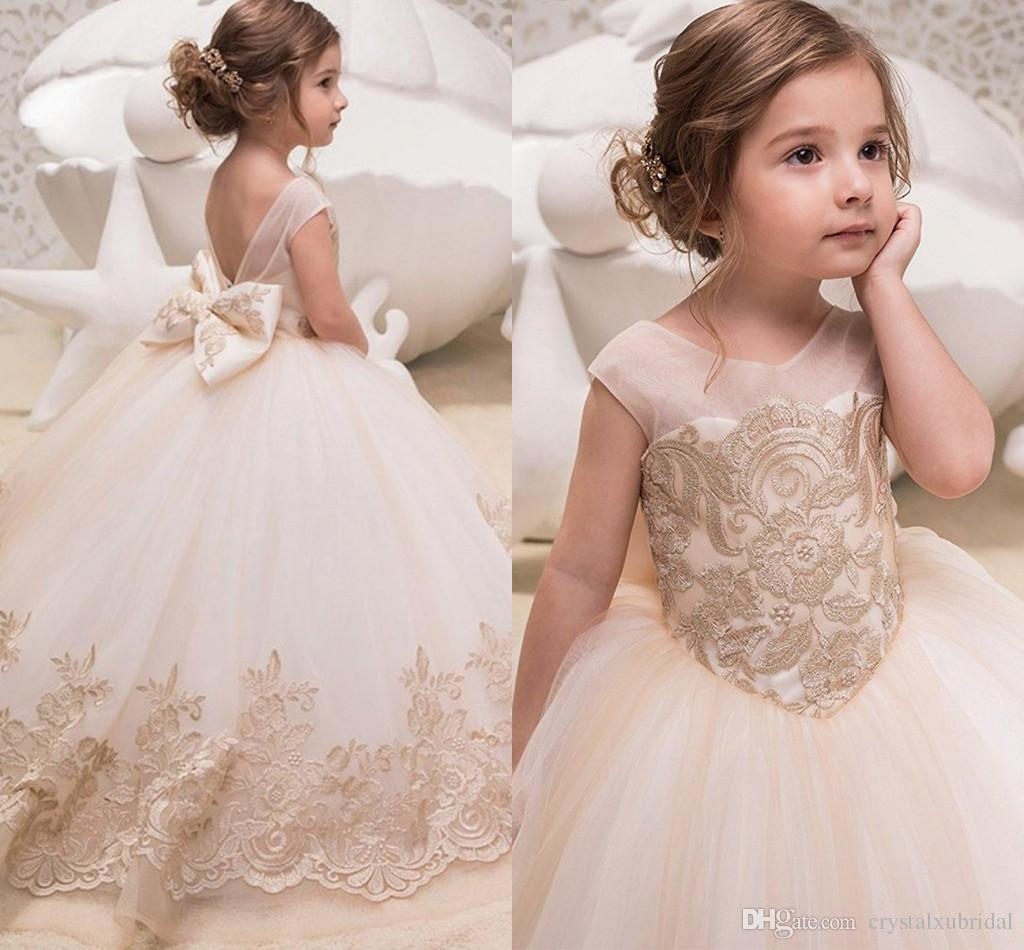 9b998f8deef 2018 Cute Champagne Flower Girls Dresses Lace Appliques Jewel Neck Tulle  Princess Long Backless Bow Children Kids Party Communion Gowns Girl Flower  Girl ...