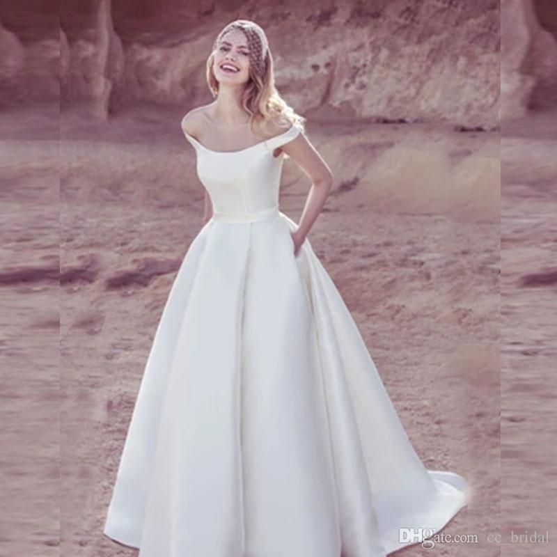 d04e0651816b8 Discount Charming Plus Size Satin Wedding Dresses 2018 Sexy Off Shoulder  White A Line African Women Bridal Dress Gown With Pocket Bridal Gowns Top  Of The ...