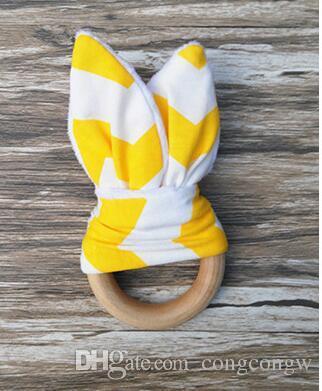 Nuevo Bebé Mordedor Anillo de madera Bebé Molares Dientes Juguetes de entrenamiento Bebés Mano Sonajeros Recién nacidos Regalo de Babys Ejercicios Juguetes Dientes juguete de entrenamiento KKA1